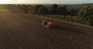 aerial photograph tractor at sunset